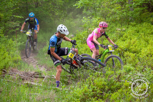 Vicki Barclay (Stan's NoTubes Elite Women's Team) passes Russel Henderson (Crosstown Velo) on an enduro segment at the NoTubes Trans-Sylvania Epic. Photo by: Trans-Sylvania Epic Media Team