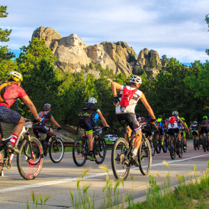 Lee Simril reaches into his back pocket in the shadows of Mount Rushmore - Photo by Jennifer Bush