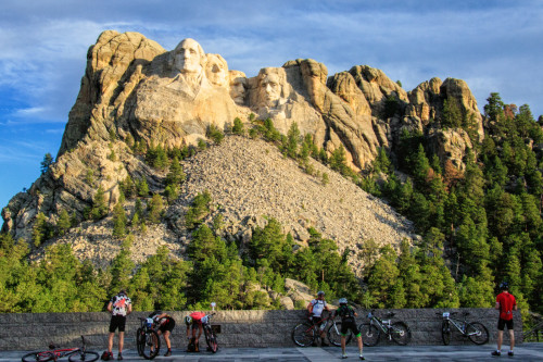 Riders stop to take in a truly unique experience at the base of Mount Rushmore - Photo by John Bush