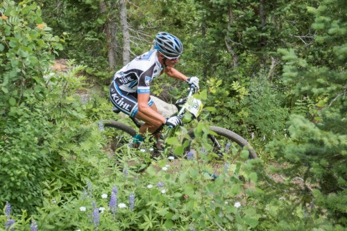 Joey Lythgoe flows through the wild flowers at Snowbird - Photo by Angie Harker