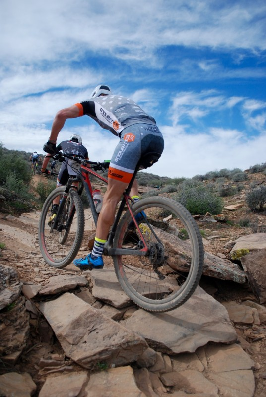 Kevin Day follows Adam Brown over some rocks. Photo by: Shannon Boffeli