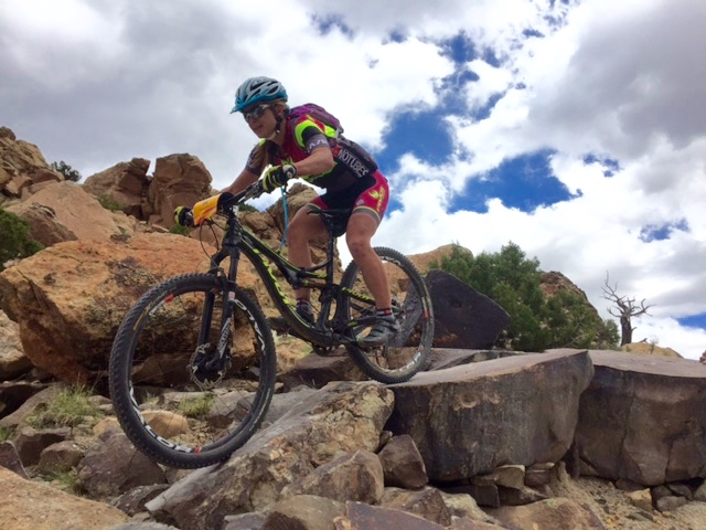 Marlee Dixon (Pivot/DNA Cycling) takes a drop on Andy's Loop. Photo by Shannon Boffeli