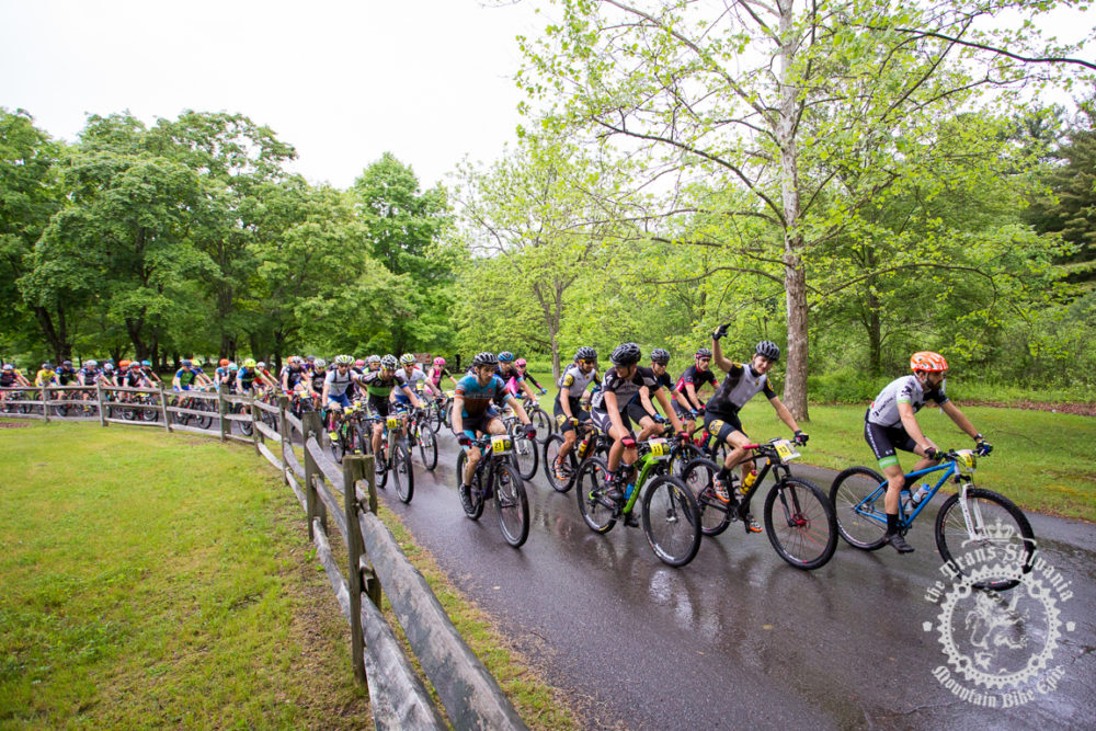 The peloton rolls out for the fifth and final time at the NoTubes Trans-Sylvania Epic. The rain held off for the start, but a 45-minute deluge drenched racers and trails mid-stage, making the rocks even more challenging than usual.
