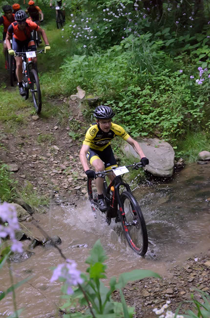 Christian Tanguy powers through the water early on in this 100 mile challenge. Photo by: Butch Phillips Photography