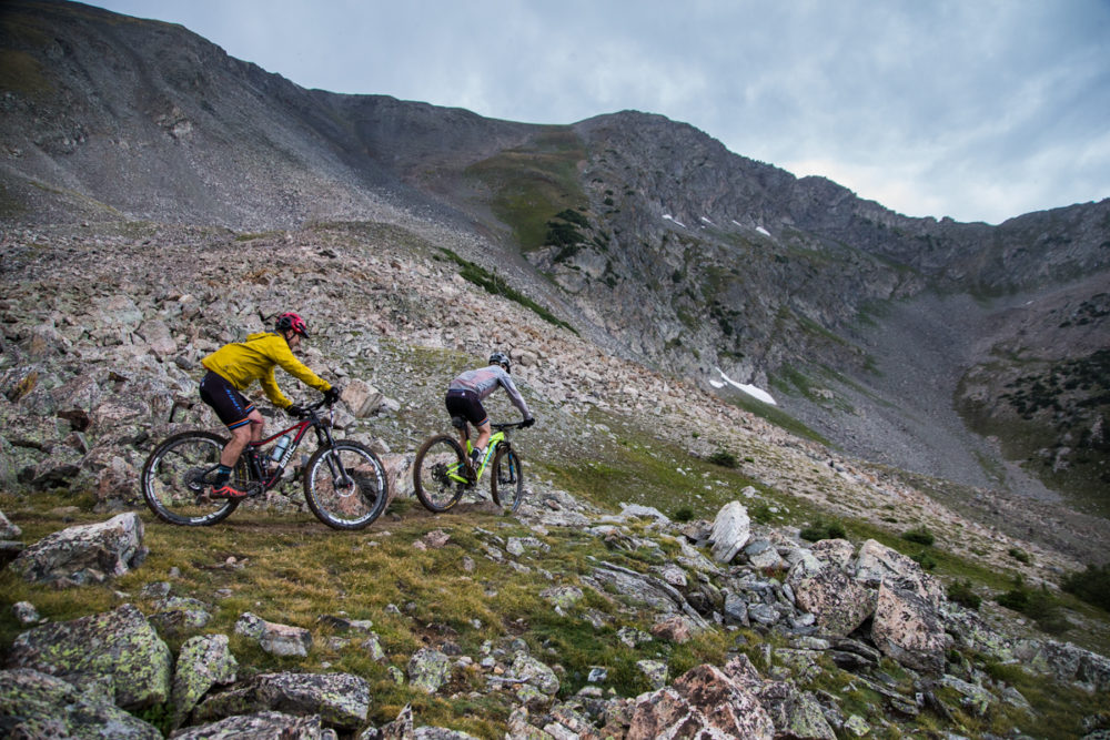 The grassy wet-land-esque fields at the summit of Wheeler can be technical, especially for exhausted riders. Photo by: Liam Doran