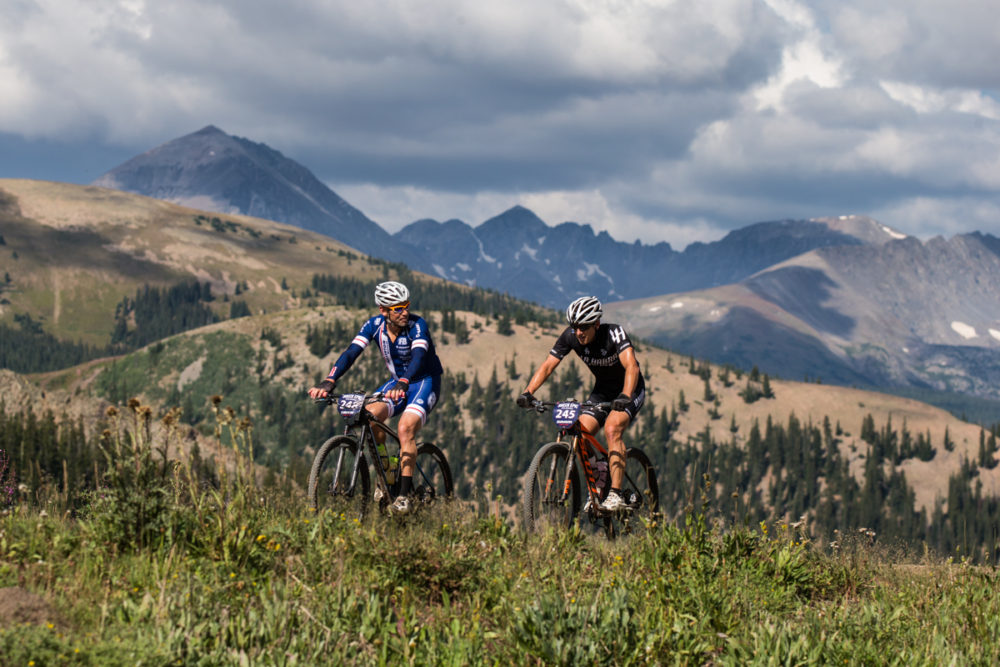 A rider gives one final look back at the expansive landscapes and views that were plentiful throughout the entire week of racing. Photo by: Liam Doran