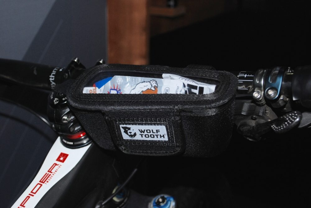 Wolf Tooth's bar-mounted container is perfect for food. The magnetic velcro closure means it shuts itself after removing your goodies.